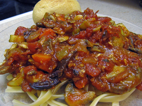 Olives, Tomatoes, and Zucchini Red Sauce over Fettuccini