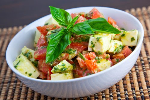 Tomato and Cucumber Salad With a Pesto Like Dressing.