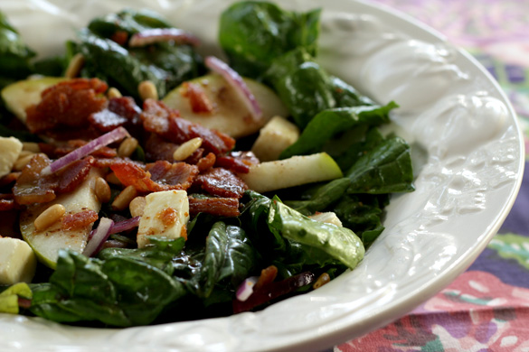Warm Spinach salad with bacon and pine nuts